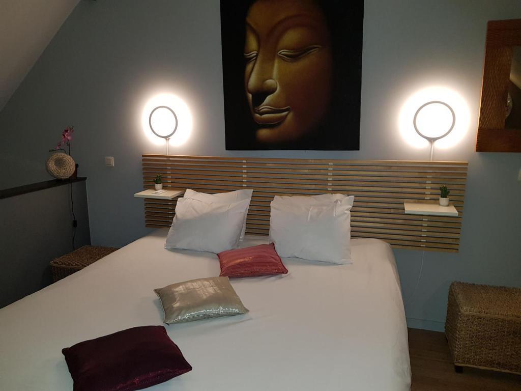Un ou plusieurs lits dans un hébergement de l'établissement B&B Osiam Spa