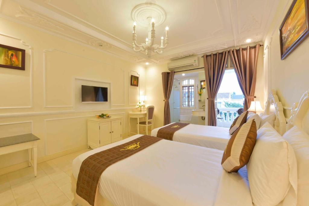 Phòng Deluxe Giường Đôi/2 Giường Đơn Có Ban Công Riêng Và Tầm Nhìn Ra Thành Phố