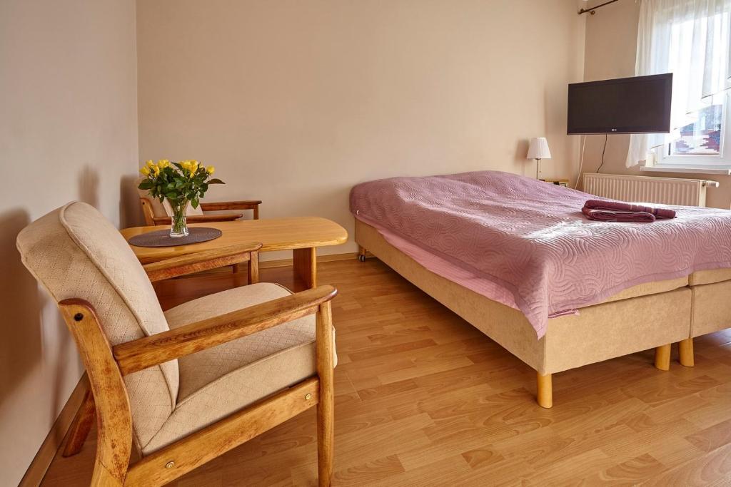 Łóżko lub łóżka w pokoju w obiekcie Vega