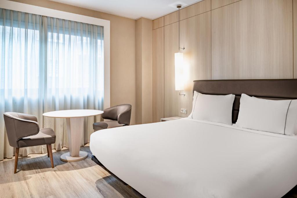 A bed or beds in a room at AC Hotel Irla
