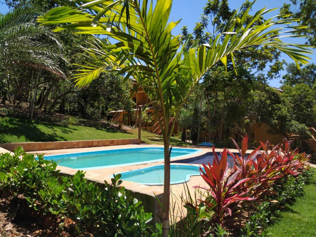 The swimming pool at or close to Vila Hen Praia do Forte