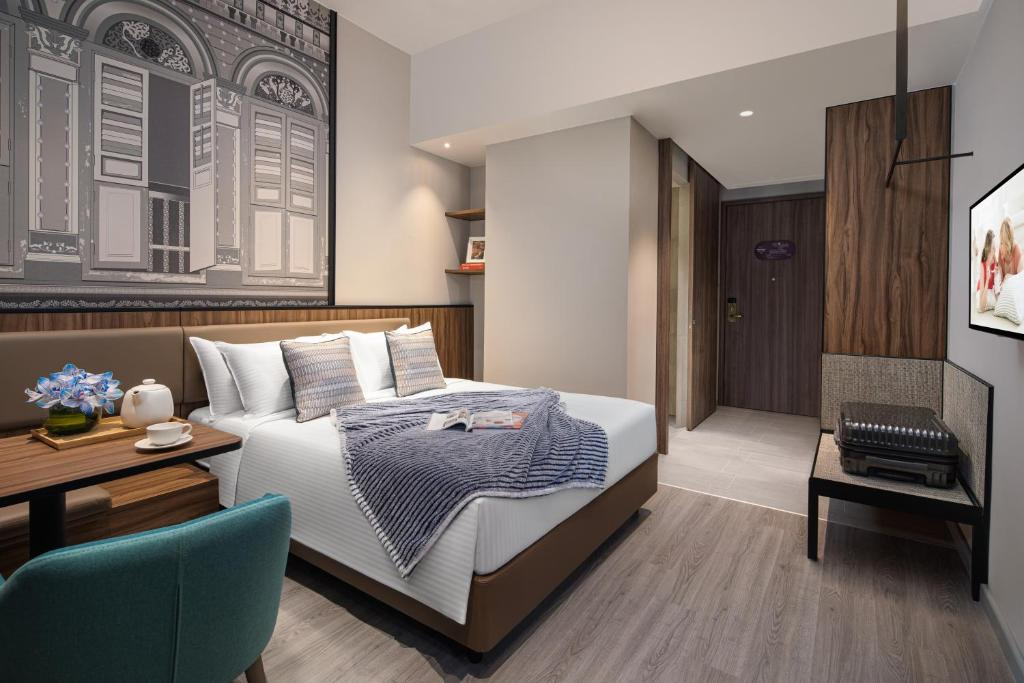 A bed or beds in a room at Citadines Rochor