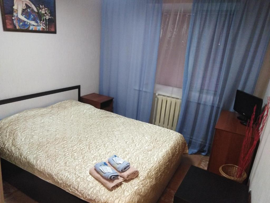 A bed or beds in a room at Butlerov Hostel
