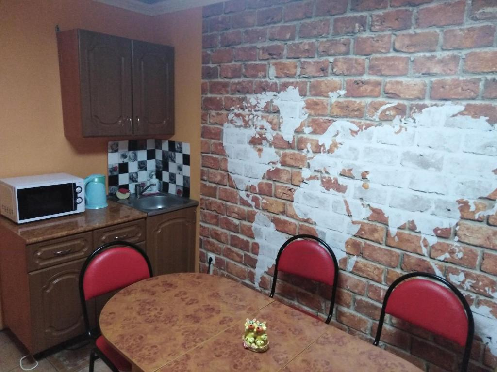 A kitchen or kitchenette at Butlerov Hostel