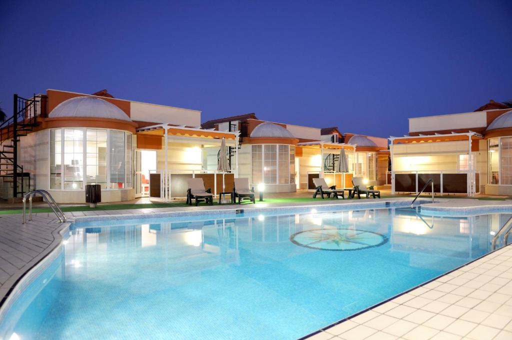 The swimming pool at or close to Siesta Suites