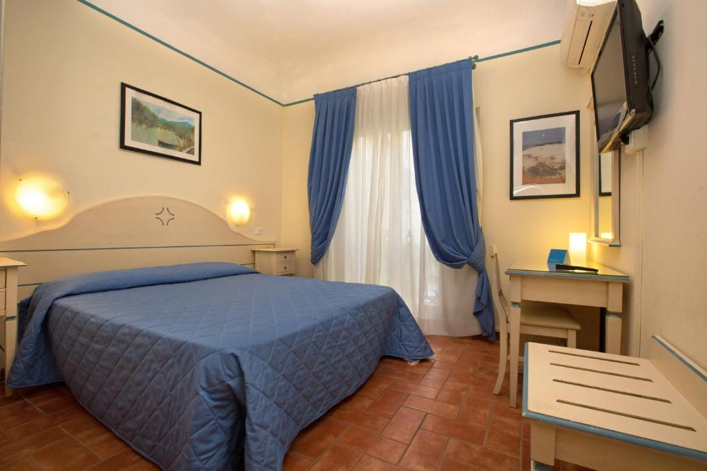 Кровать или кровати в номере Hotel Crocini