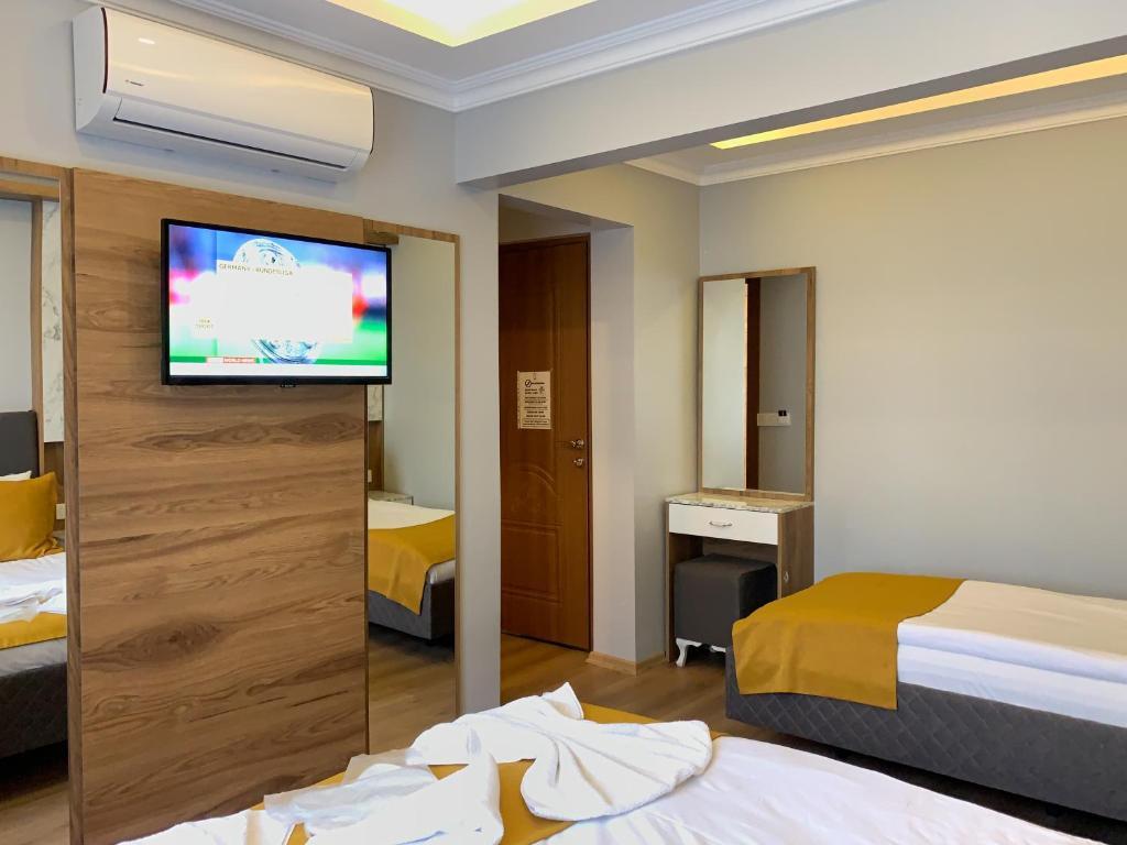 Телевизор и/или развлекательный центр в Sultanahmet Nu Hotel