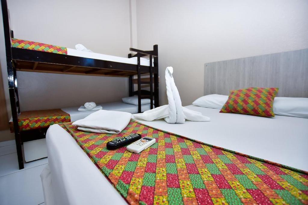 A bunk bed or bunk beds in a room at Pousada Praia de Pajuçara