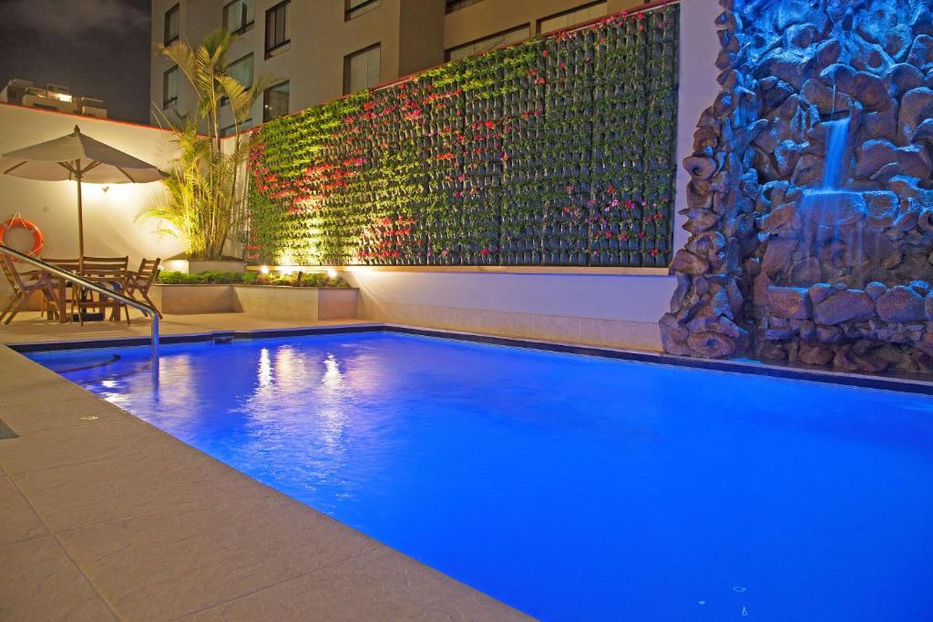 The swimming pool at or near Radisson San Isidro Hotel & Suites