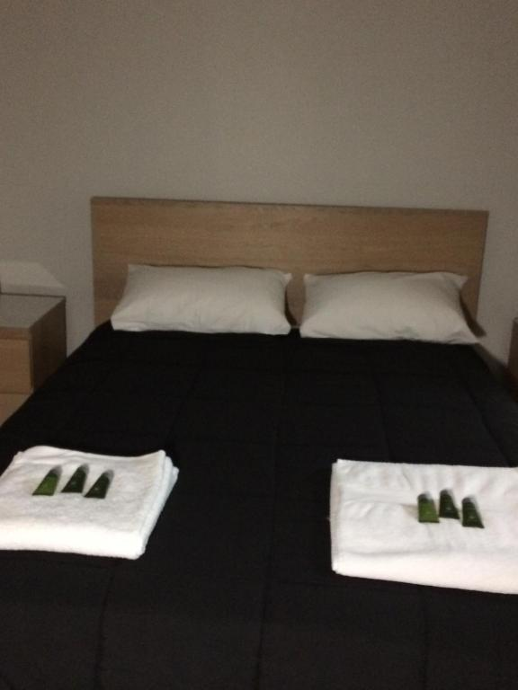 A bed or beds in a room at Native Rose Hotel