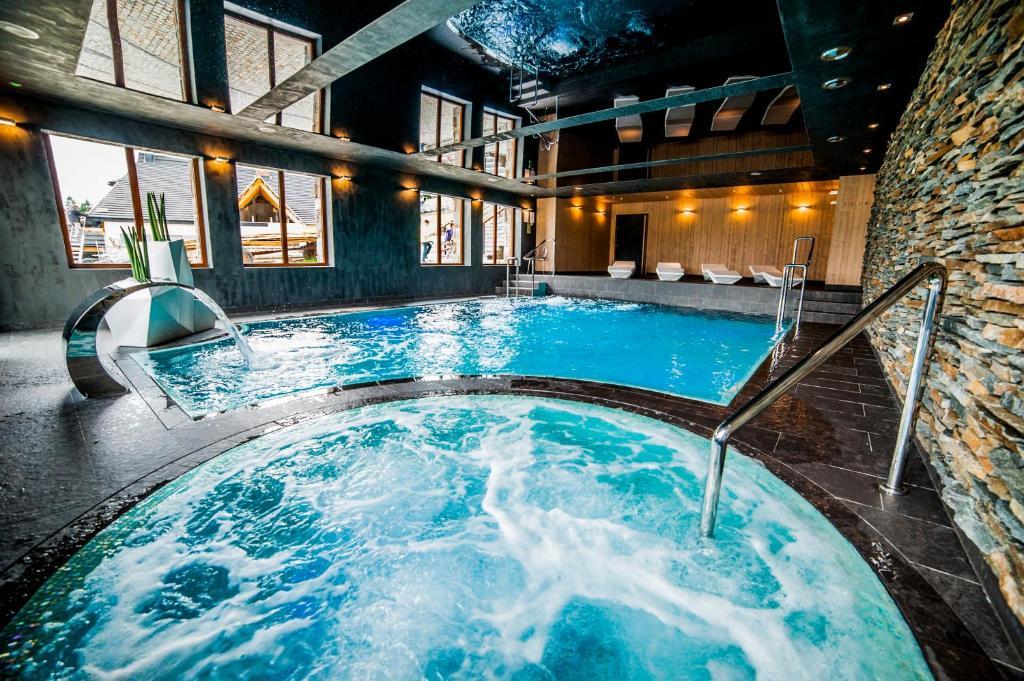 The swimming pool at or close to Hotel Zawrat Ski Resort & SPA