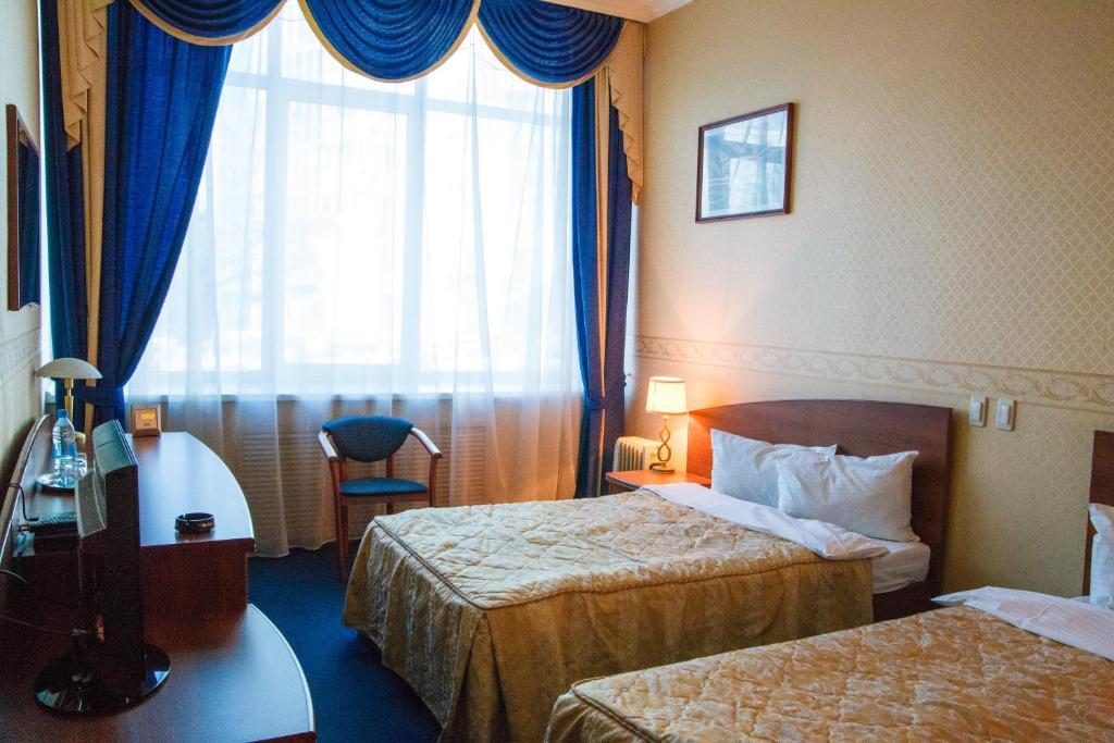 Кровать или кровати в номере Отель Феникс