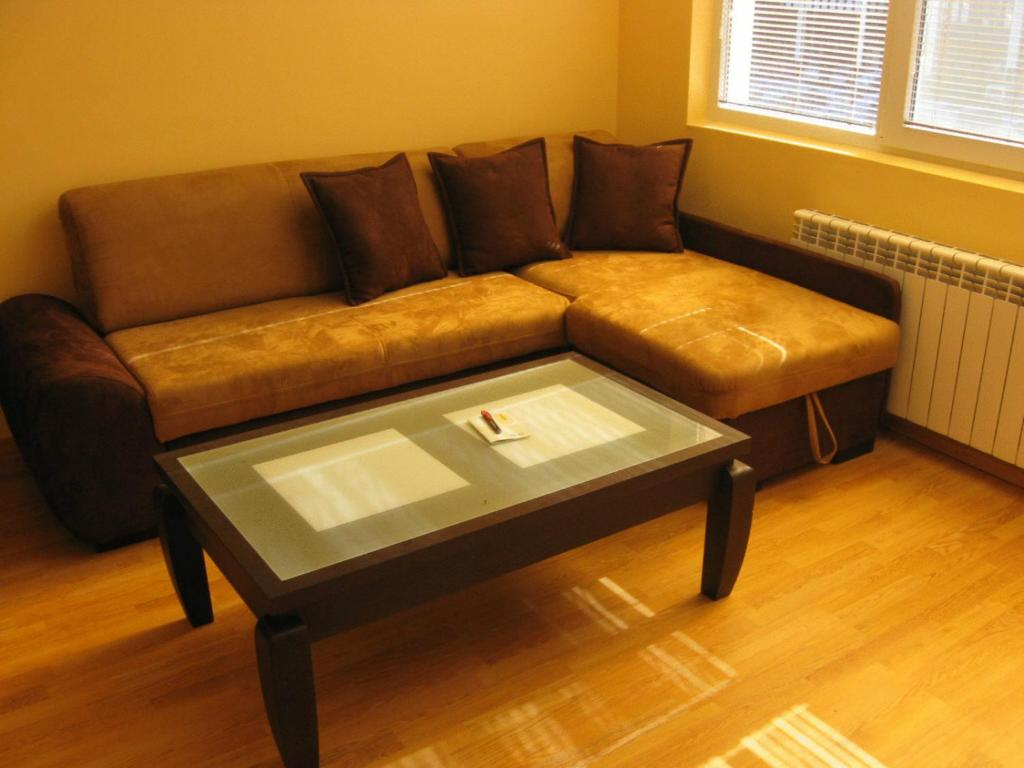 A seating area at Apartments Borovets