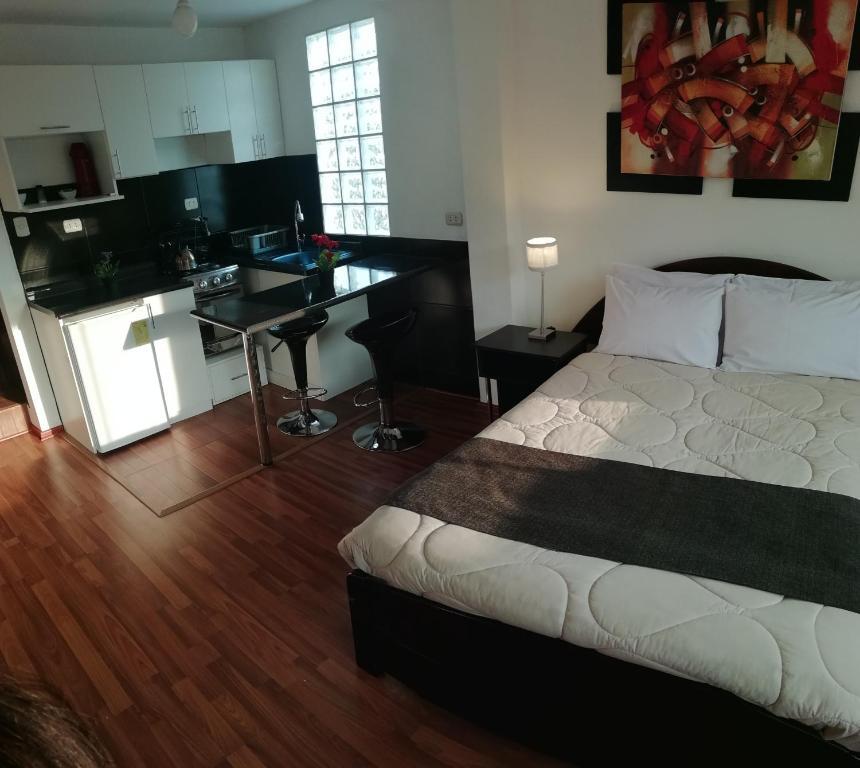 Cama o camas de una habitación en Allincay Cusco Apart Hotel