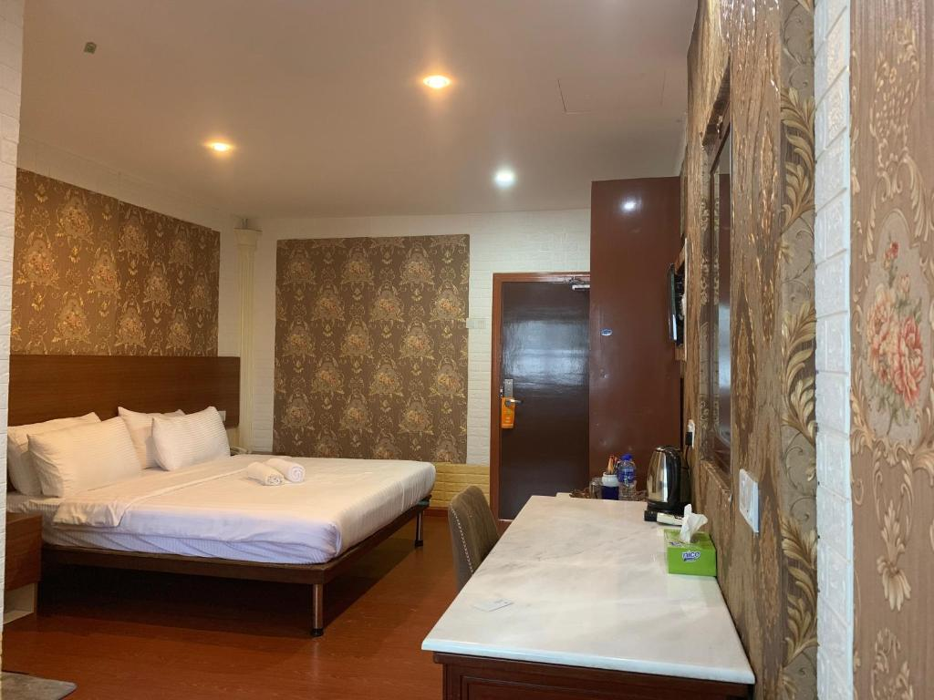Katil atau katil-katil dalam bilik di Hotel Easy Crystal