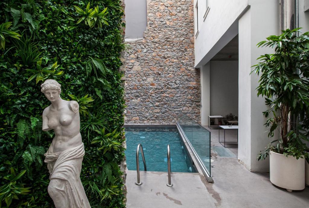 The swimming pool at or near Art Suites Korai