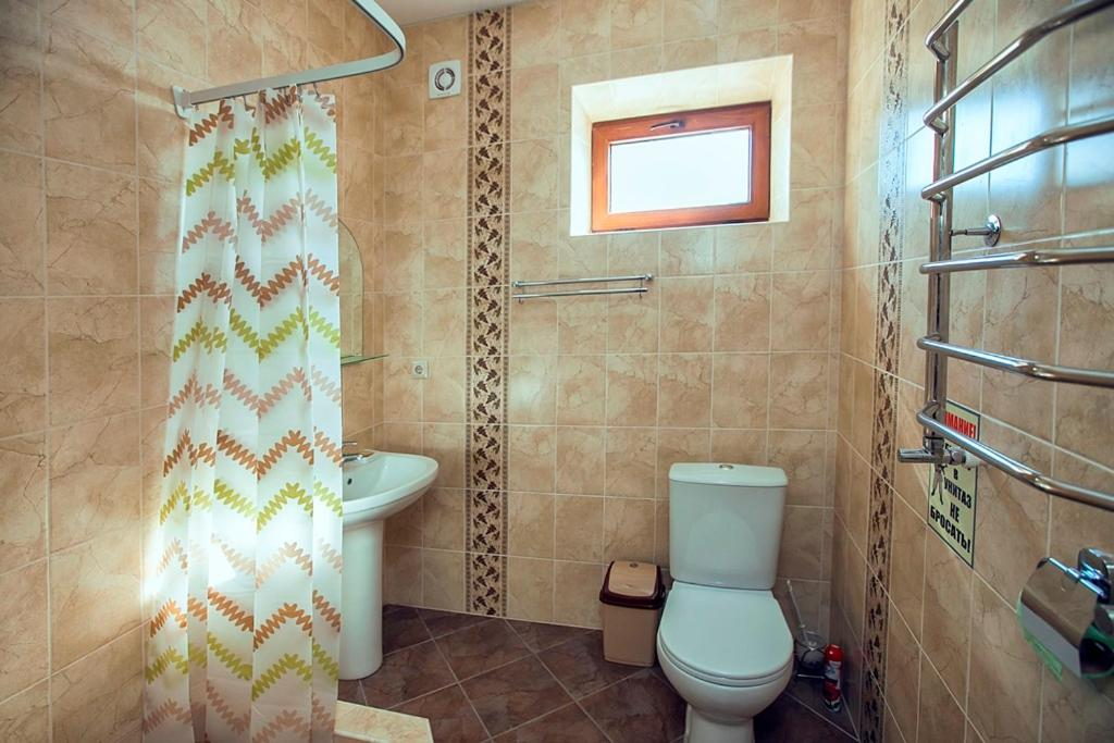 Ванная комната в Guest House Azovsky Bereg