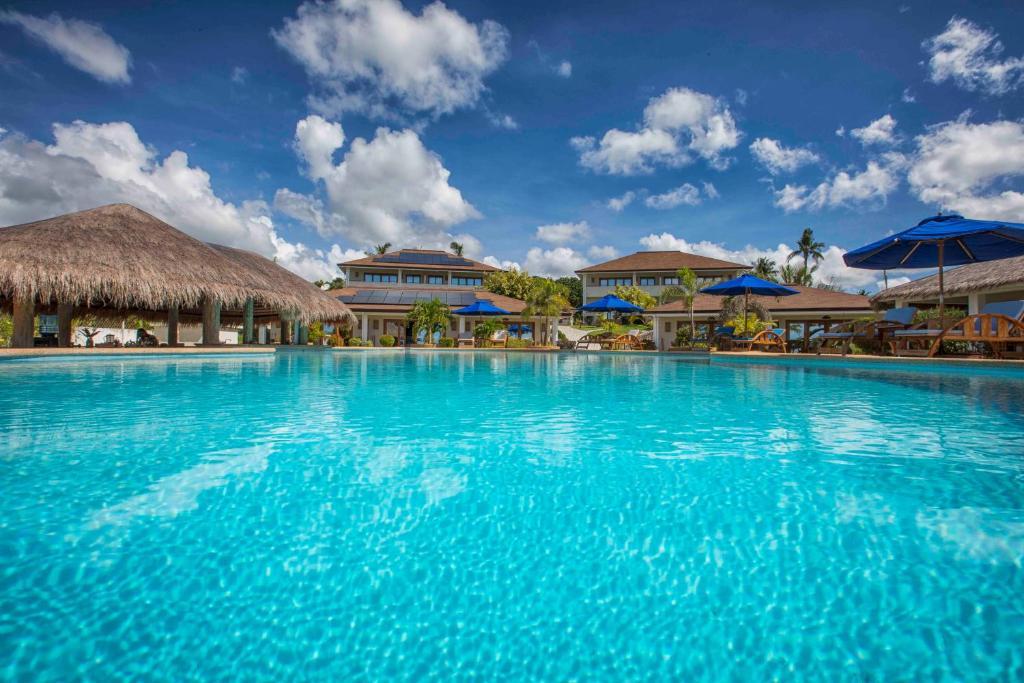 The swimming pool at or near Salamangka Beach and Dive Resort