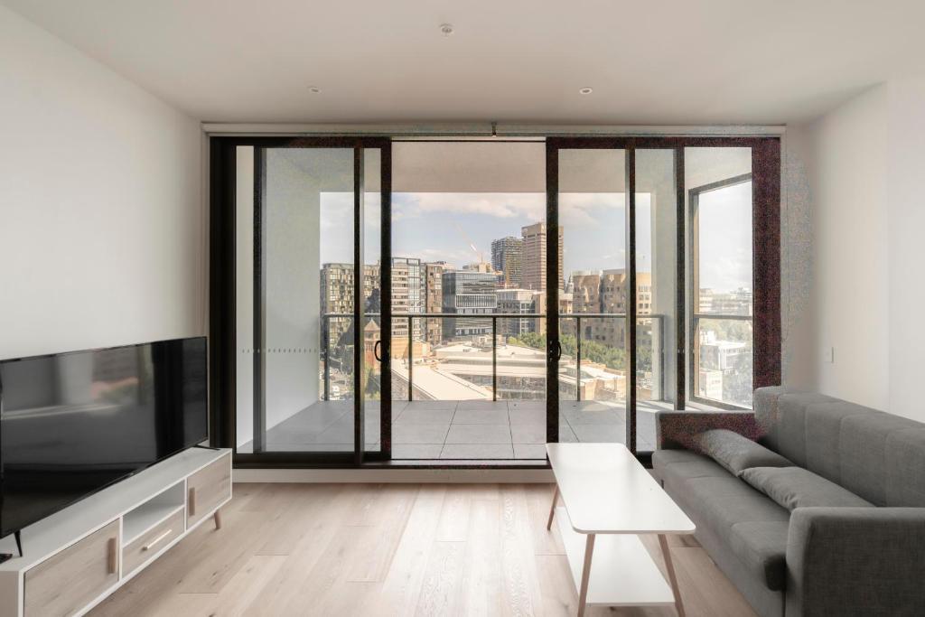 Ein Sitzbereich in der Unterkunft Modern Apartment in Sydney's Darling Harbour CBD