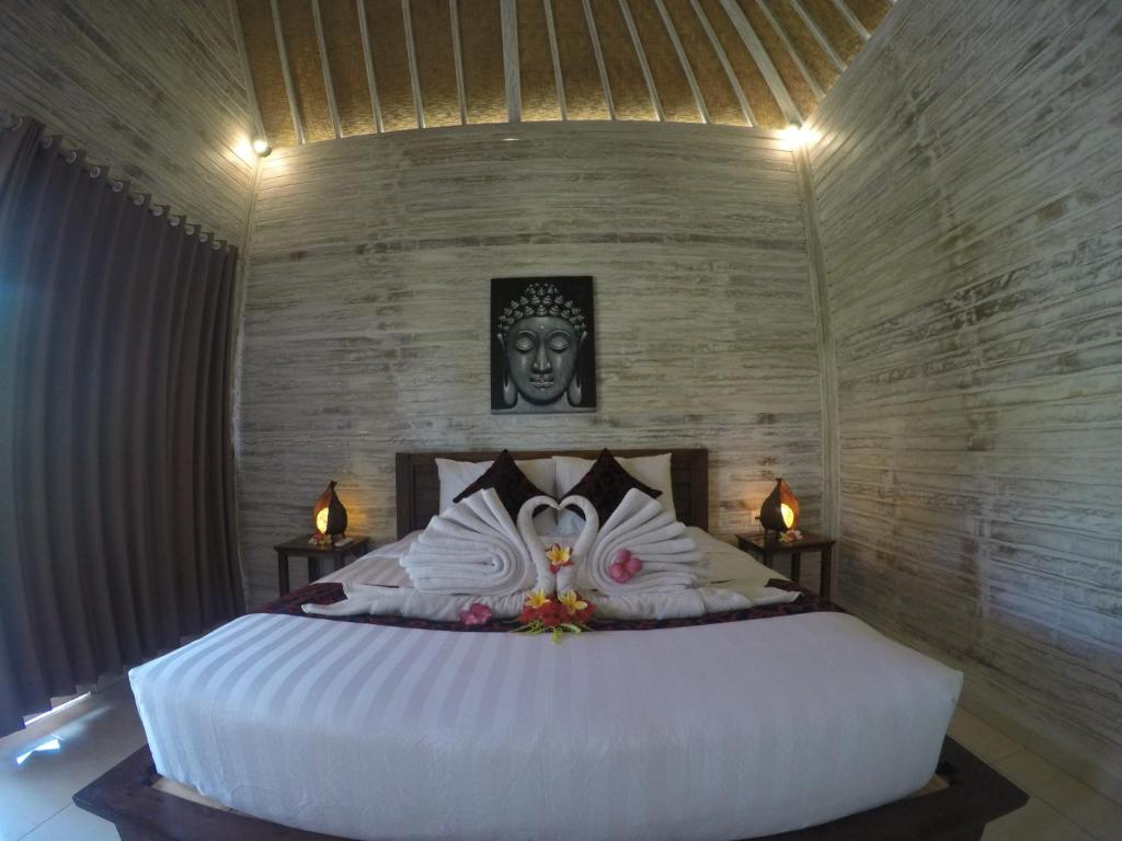 A bed or beds in a room at The Omah