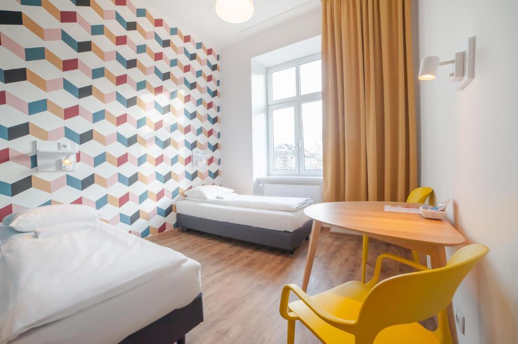 Un ou plusieurs lits dans un hébergement de l'établissement Atlantis Hostel