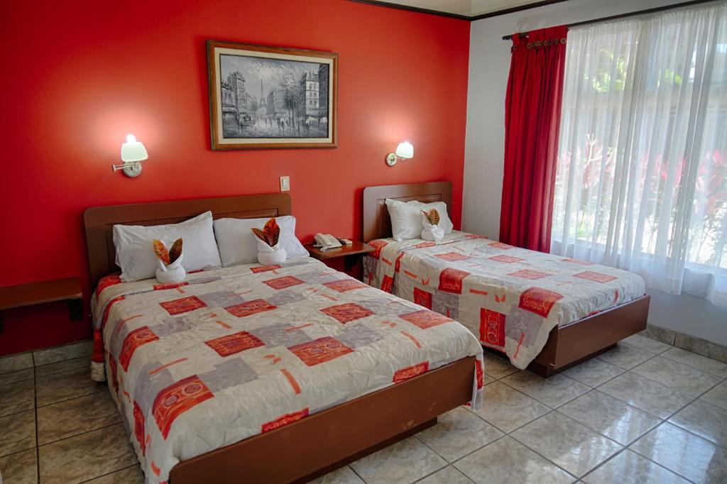 A bed or beds in a room at Hotel Arenal Rabfer