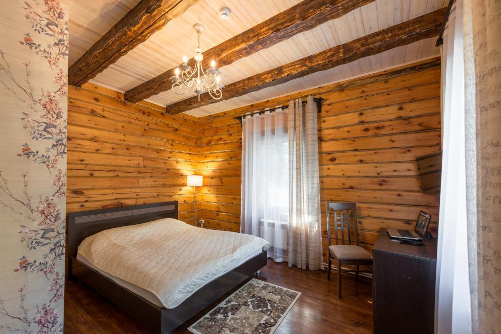 A bed or beds in a room at Leontopodium Teletskoye