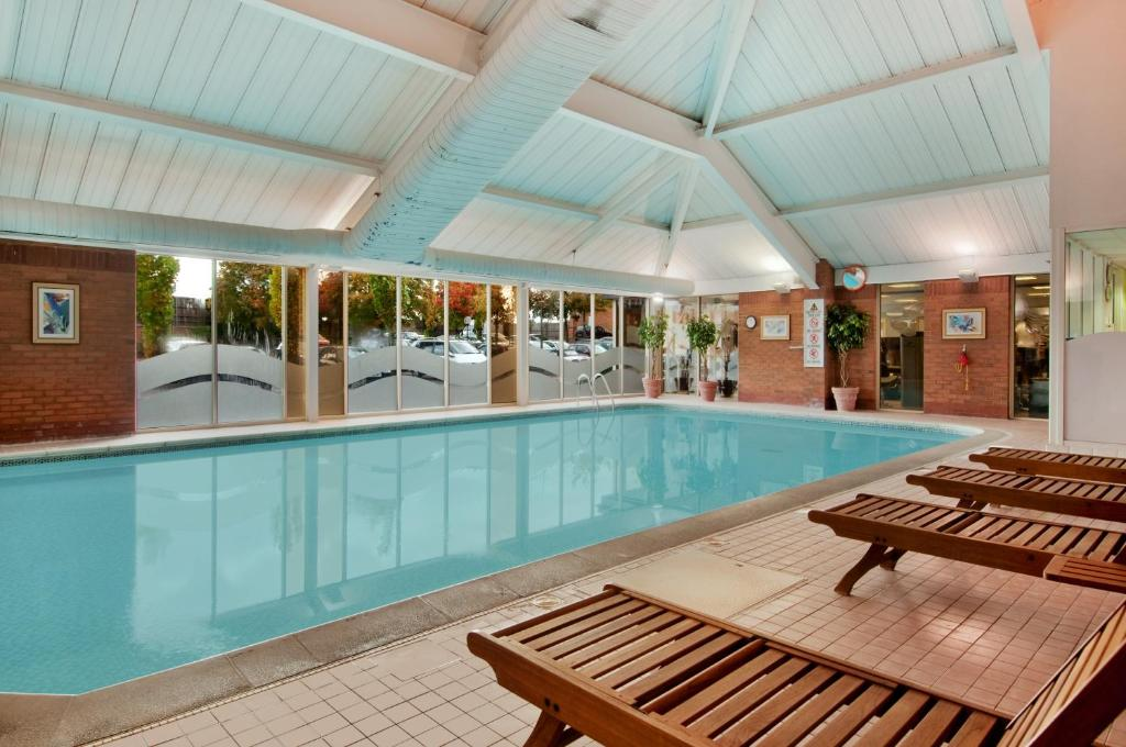 The swimming pool at or near DoubleTree by Hilton Newbury North