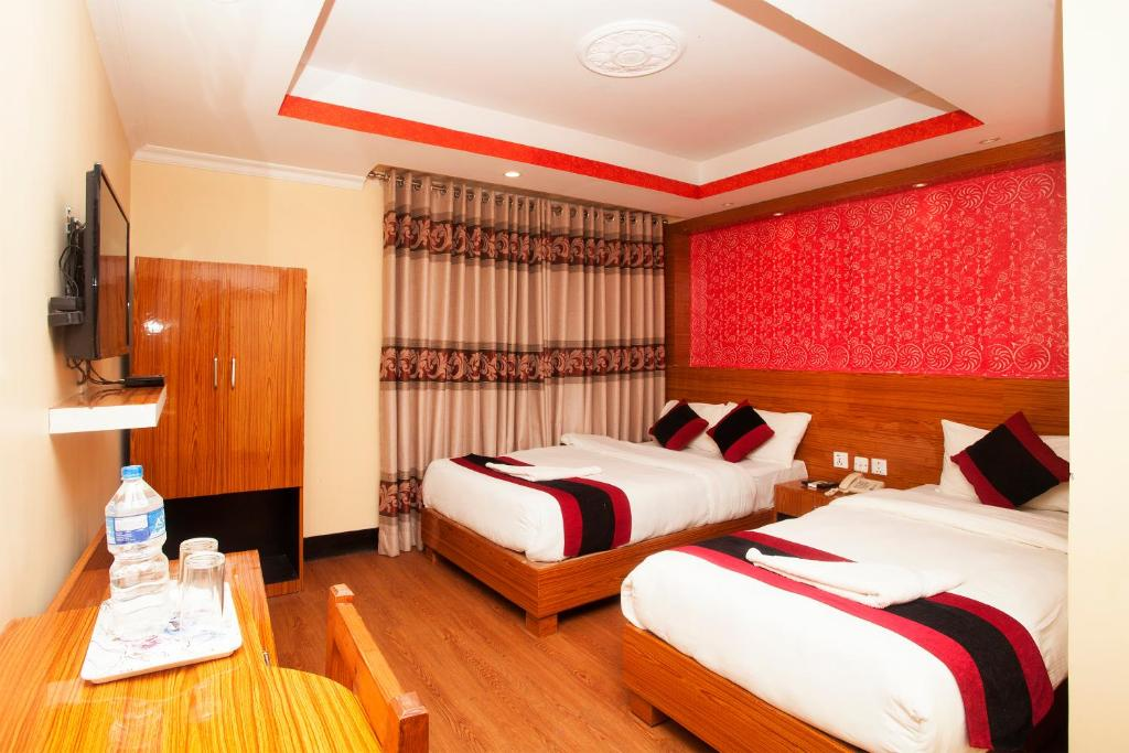 A bed or beds in a room at Kathmandu Regency Hotel