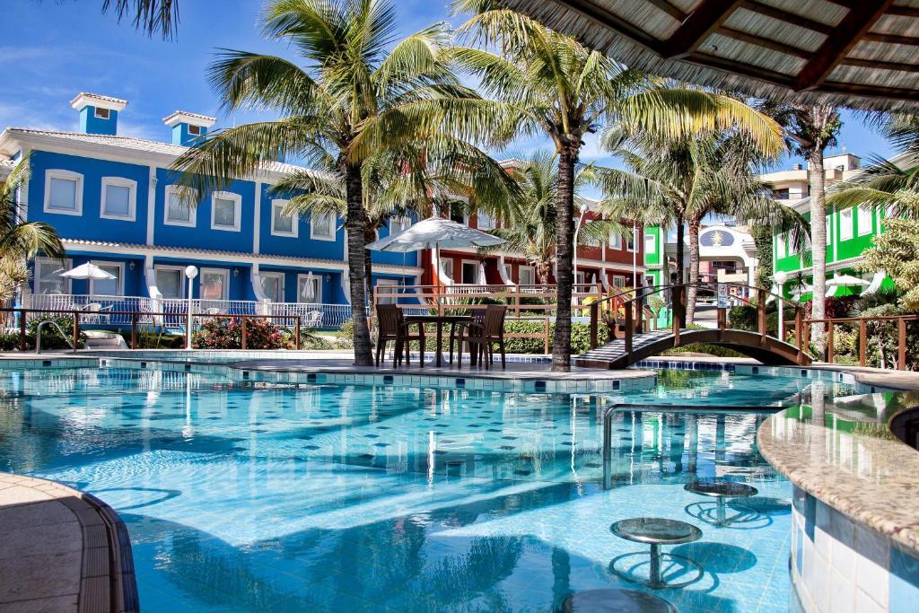 The swimming pool at or near Hotel Vila do Farol