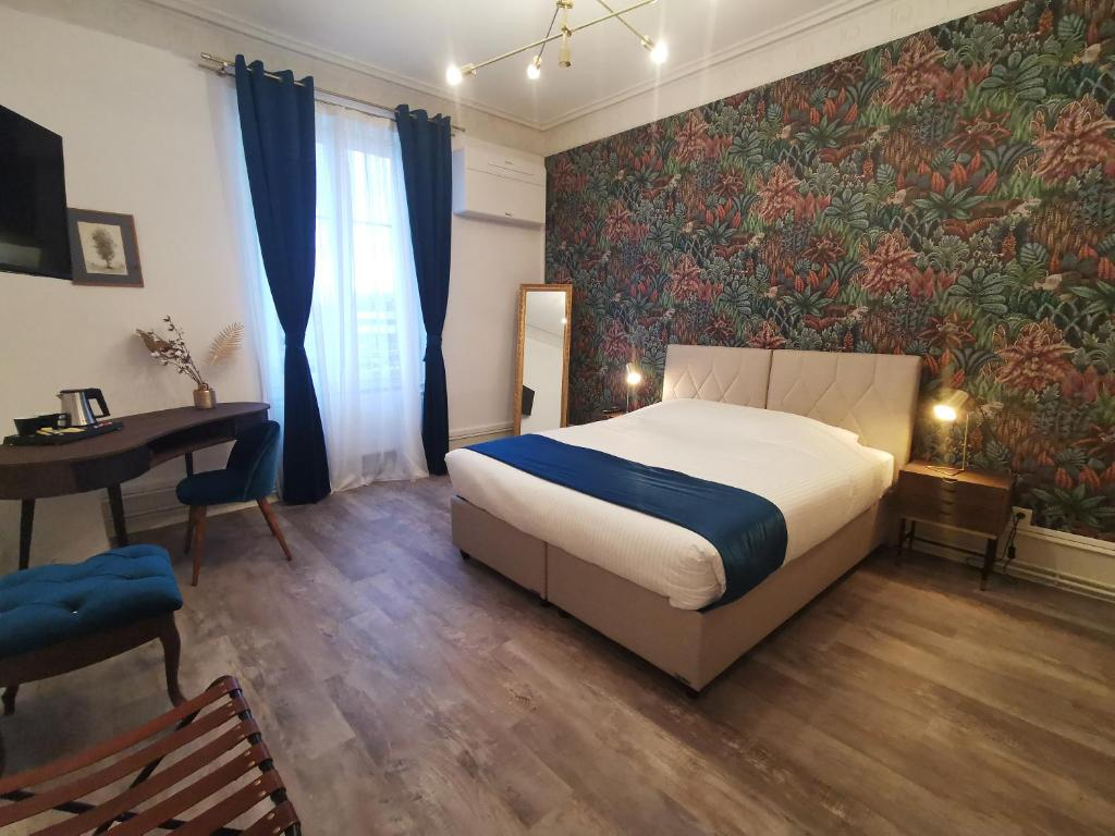Ein Bett oder Betten in einem Zimmer der Unterkunft Colmar Suites