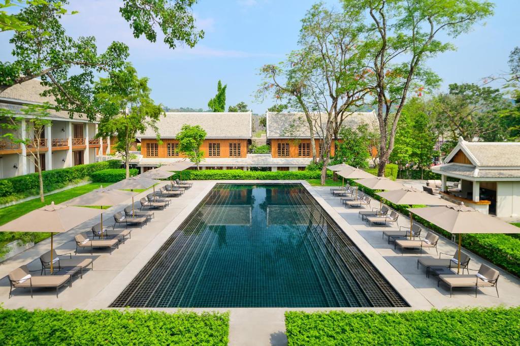 The swimming pool at or near Avani+ Luang Prabang Hotel
