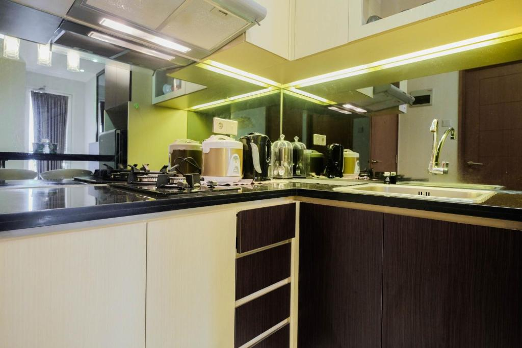 Luxurious And Comfy 2br Cinere Bellevue Suites Apartment By