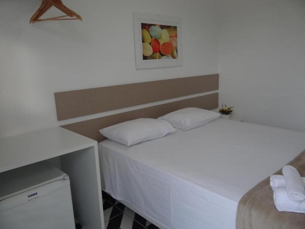 Cama ou camas em um quarto em Sargaço Pousada