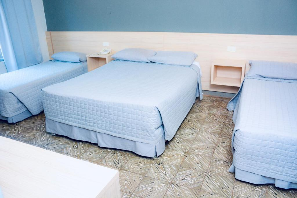 A bed or beds in a room at Hotel Ciudad