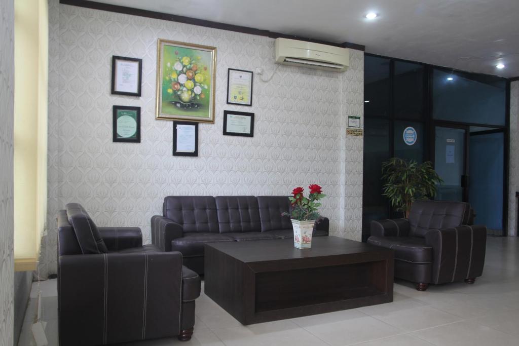 Desain Taman Kota  oyo 2104 hotel grand sabrina pangkal pinang indonesia