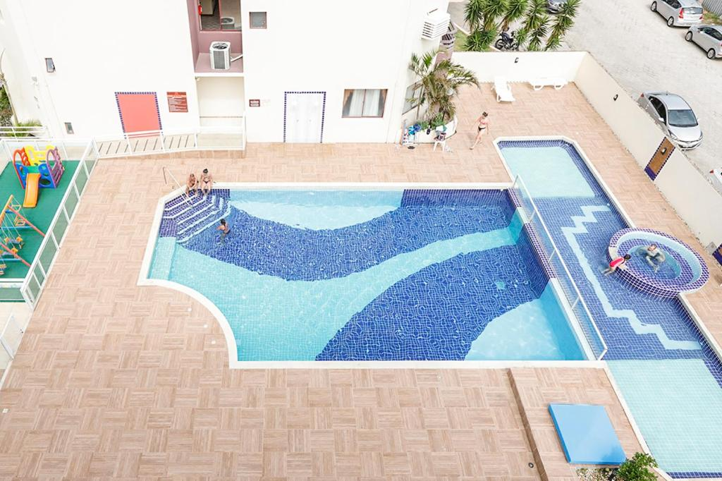 A view of the pool at Apto 1 dormitório Vista para o Mar or nearby