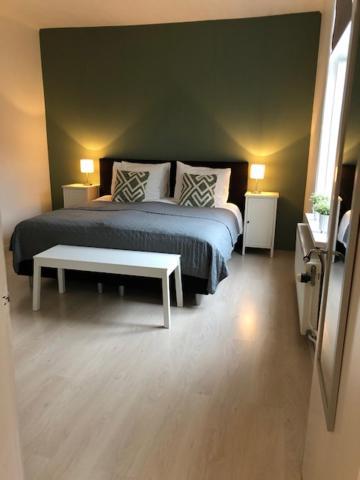 Een bed of bedden in een kamer bij Zomerhuisje