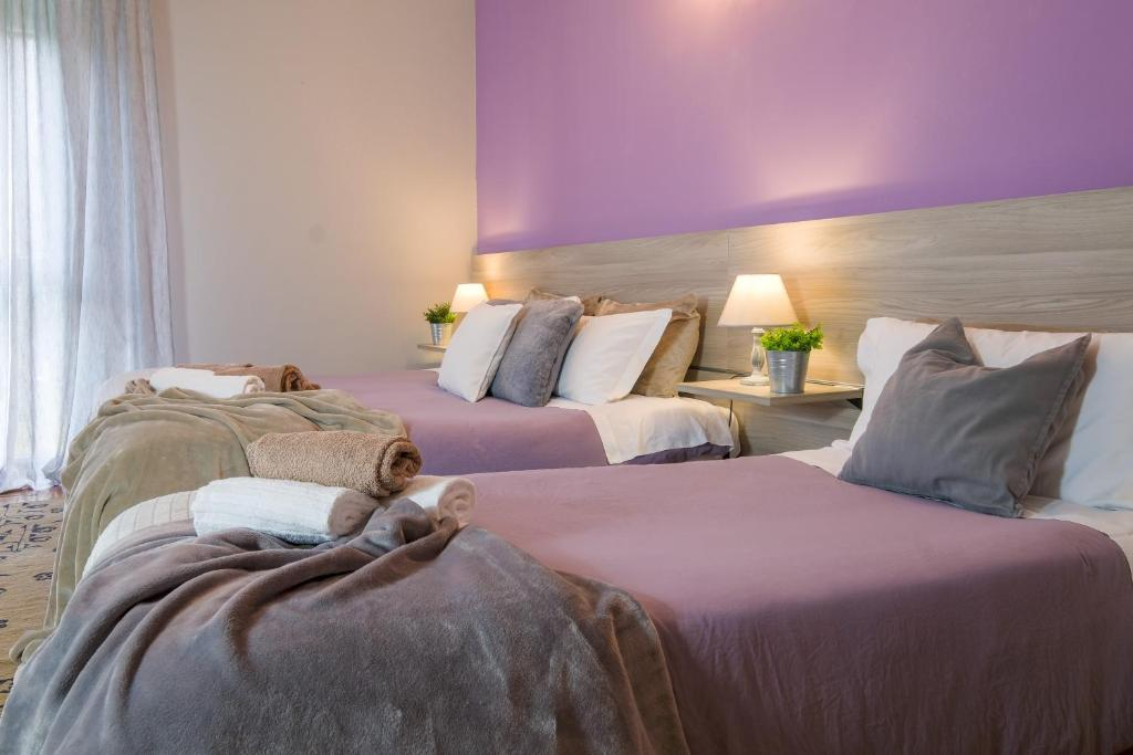 Letto o letti in una camera di Luna Lovely Rooms