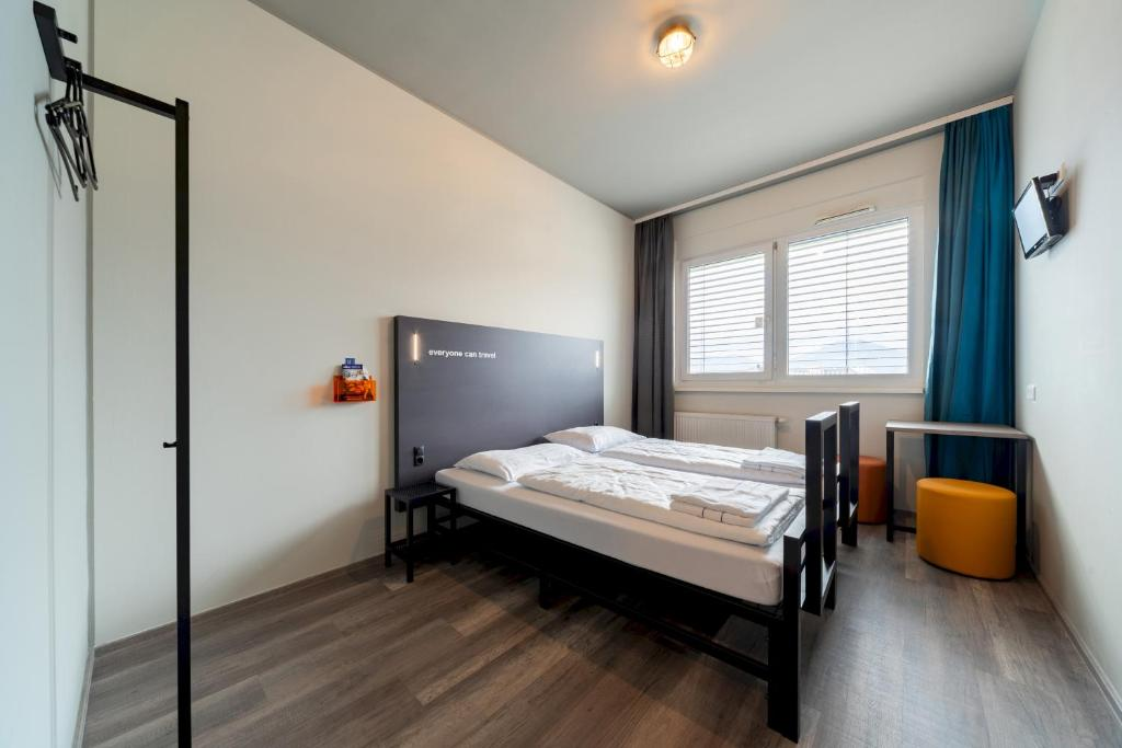 A bed or beds in a room at a&o Graz Hauptbahnhof