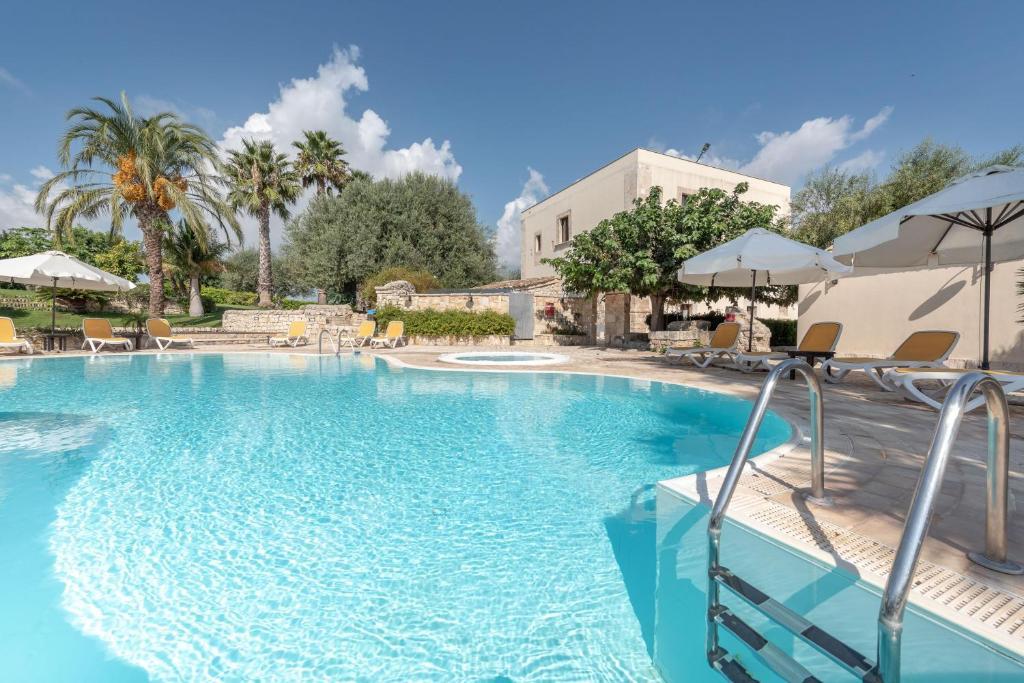 The swimming pool at or near Relais Torre Marabino