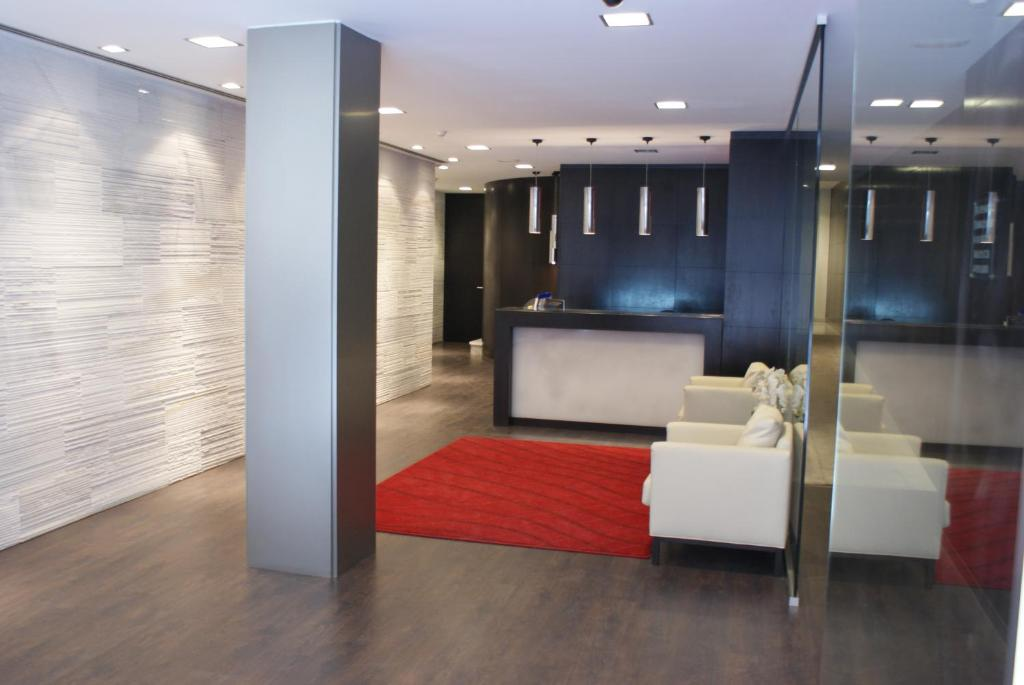El vestíbulo o zona de recepción de Hotel Universal