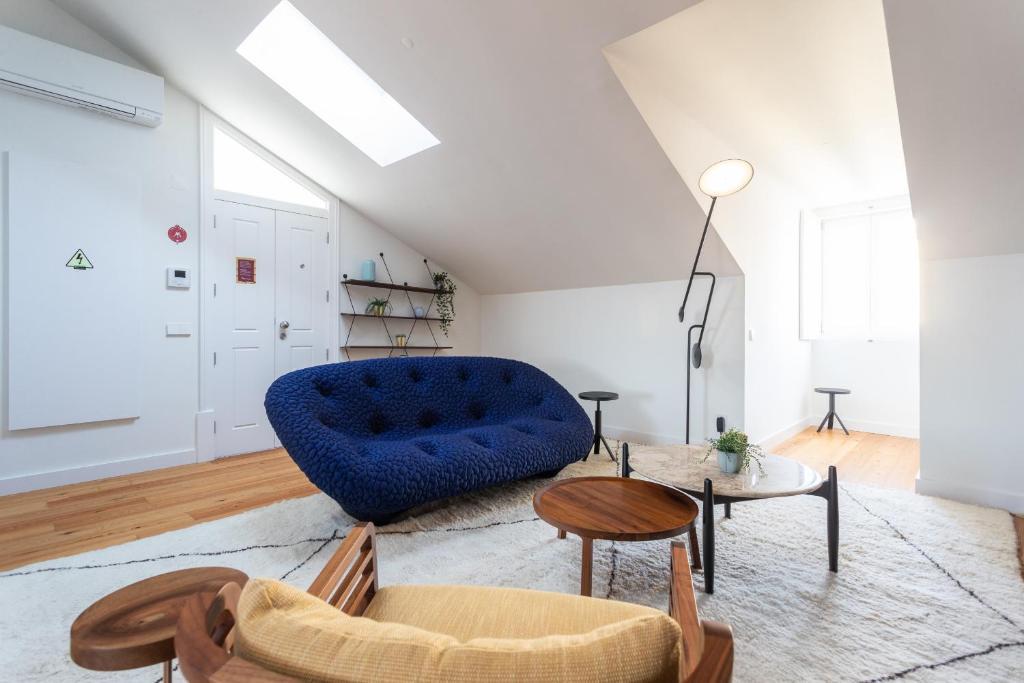 A seating area at Feels Like Home Martim Moniz Trendy Flat