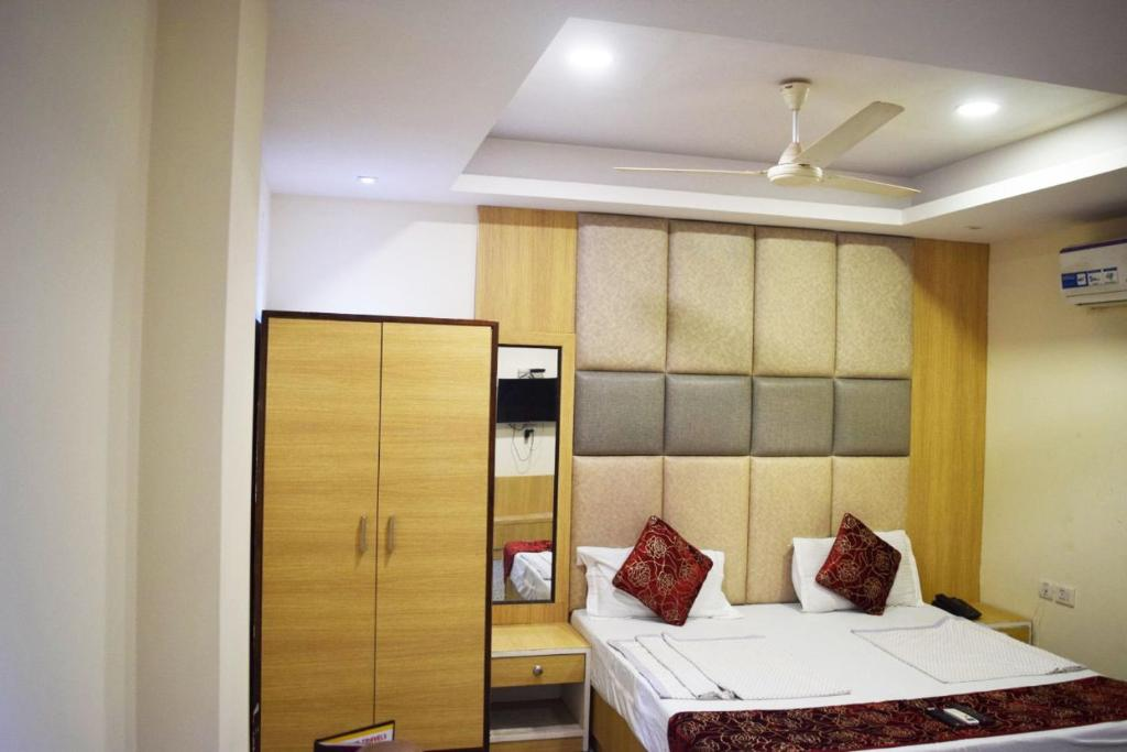 A bed or beds in a room at The Paramont Suites Delhi