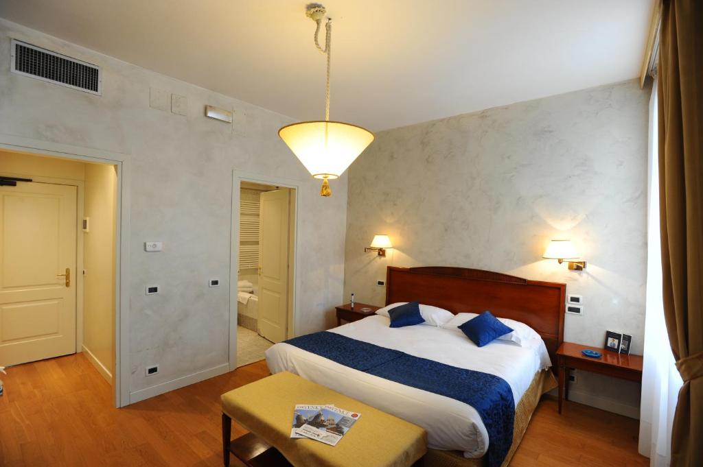 מיטה או מיטות בחדר ב-Locanda del Ghetto
