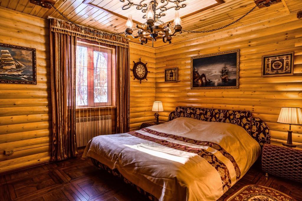 Кровать или кровати в номере Отель Раздолье