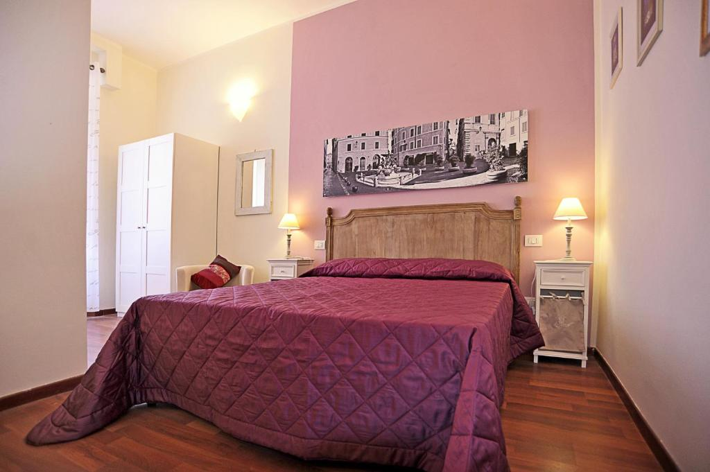 Ein Bett oder Betten in einem Zimmer der Unterkunft Piazzetta al Vaticano B&B