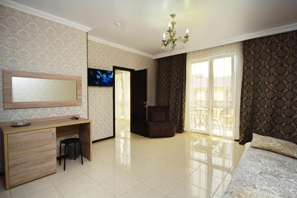 A television and/or entertainment center at AsTerias Hotel