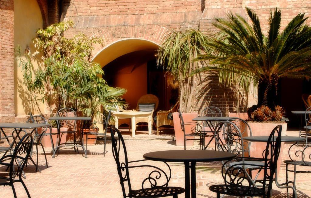 Restaurant ou autre lieu de restauration dans l'établissement Il Chiostro Del Carmine