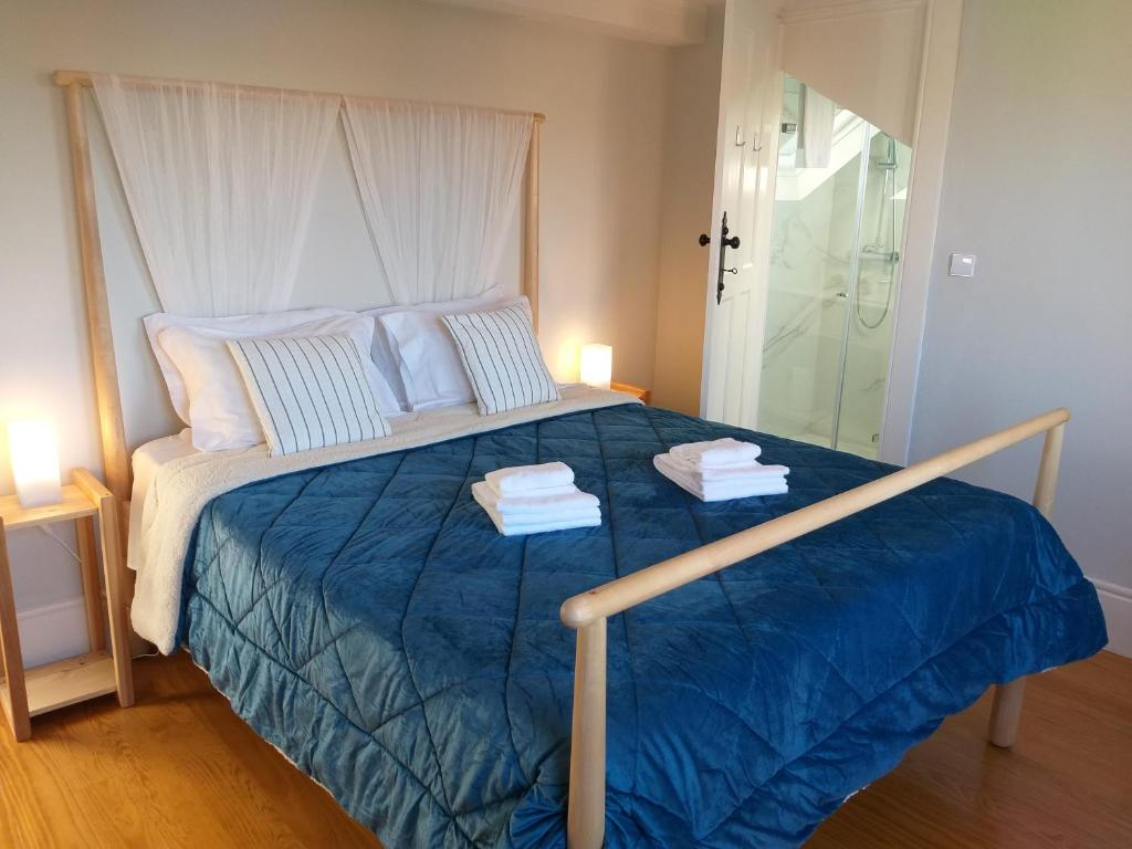 A bed or beds in a room at Jardim Do Porto